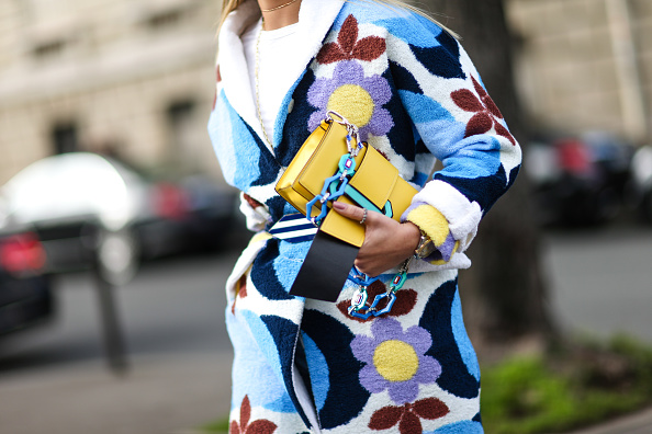 PARIS, FRANCE - MARCH 07: Thassia Naves wears a flower print coat, a white top, blue jeans, a yellow bag, and blue heels, outside the Miu Miu show, during Paris Fashion Week Womenswear Fall/Winter 2017/2018, on March 7, 2017 in Paris, France. (Photo by Edward Berthelot/Getty Images)