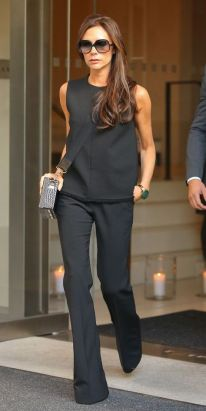 **USA ONLY** New York, NY - Victoria Beckham looks chic as she emerges from her NYC Hotel. The former Spice Girl showed off her slender figure in a sleeveless black blouse with a matching pair of flared trousers and heels. AKM-GSI September 28, 2015 **USA ONLY** To License These Photos, Please Contact : Steve Ginsburg (310) 505-8447 (323) 423-9397 steve@akmgsi.com sales@akmgsi.com or Maria Buda (917) 242-1505 mbuda@akmgsi.com ginsburgspalyinc@gmail.com